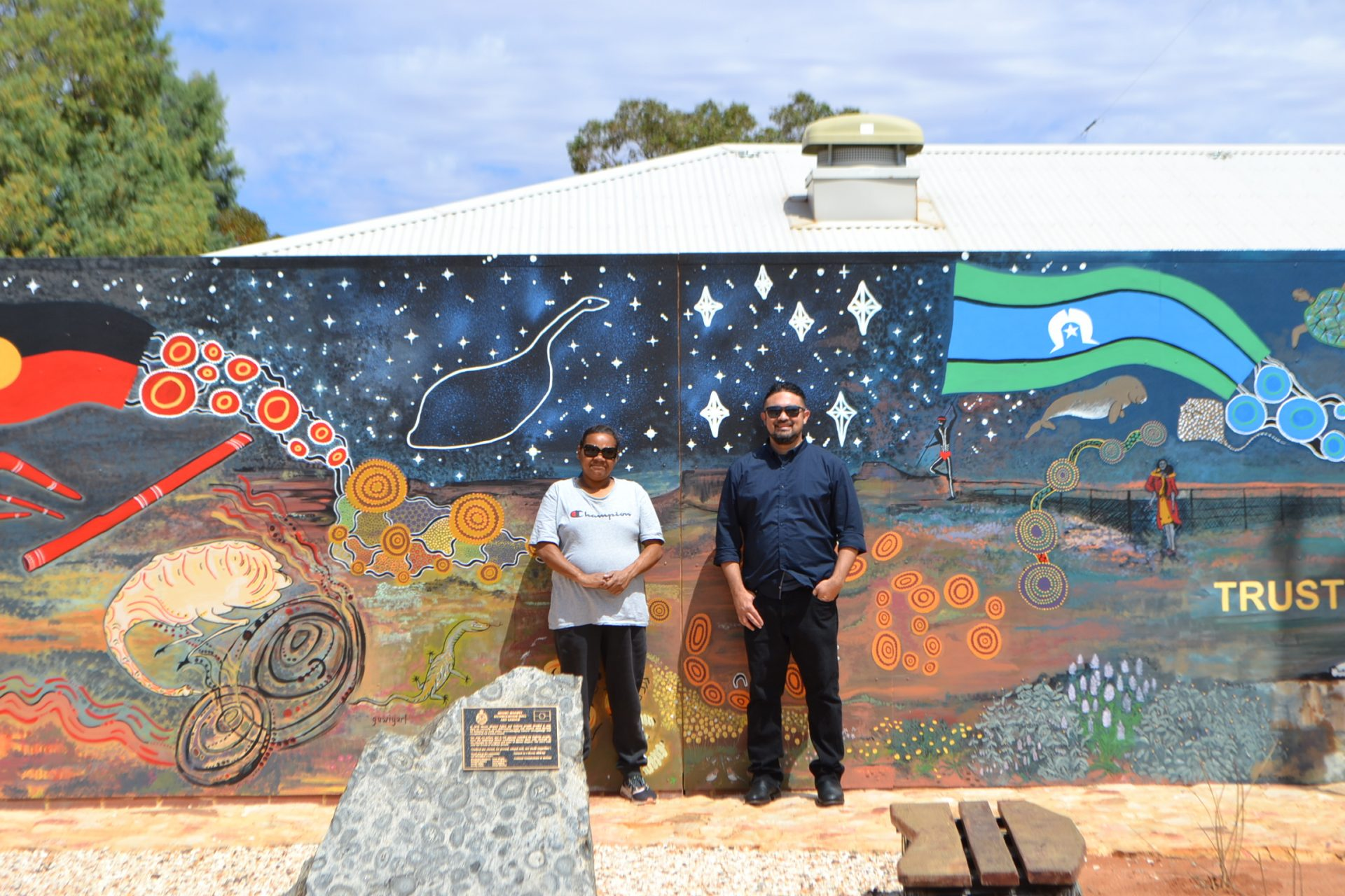 Joselyn Walsh, Art Supervisor Wirnda Barna and CEO AACHWA Chad Creighton in front of Police Station Mural completed by Wirnda Barna and local artists, Mount Magnet.